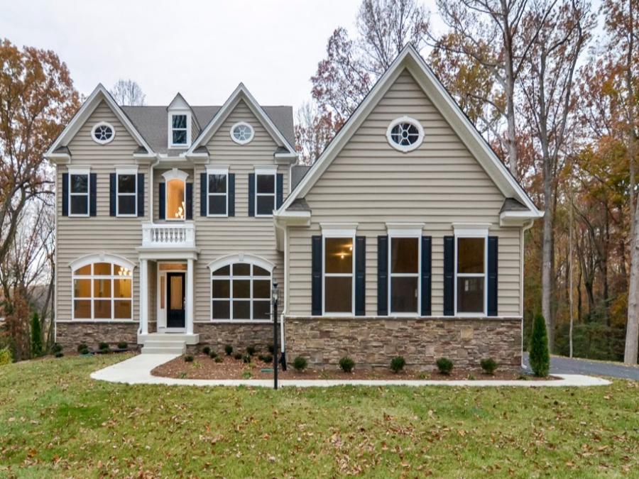 Raleigh II Elevation 3, Featuring Optional Carriage Style Garage Doors. Note: Double Garage Door is Current Offering