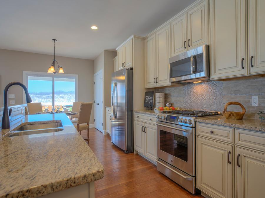 The Chesapeake with Extended Cafe, Gas Stove, Granite Countertop, Backsplash, Stainless Steel Appliances and Oil Rubbed Bronze Faucet and Lighting Package.