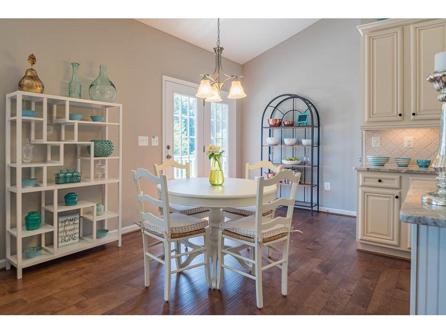 The Breakfast Nook in the Bridgewater II is spacious and leads to the deck at the Model Home in Fawn Lake.