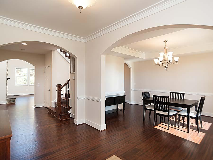 The Montgomery featuring beautiful arches and hardwoods in the Dining Room