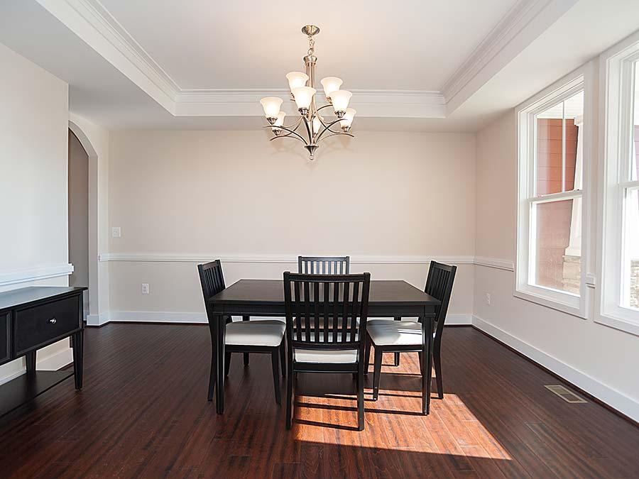 The Montgomery Dining Room featuring Hardwood flooring and a Tray Ceiling