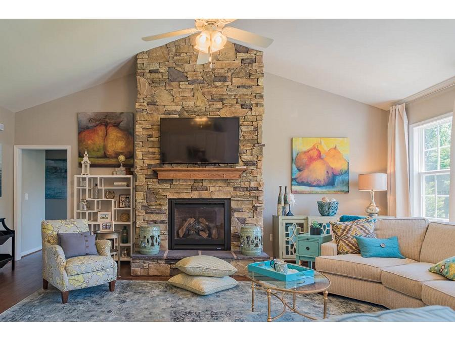 The Bridgewater II Great Room featuring Stone Fireplace Facade and Cathedral Ceiling