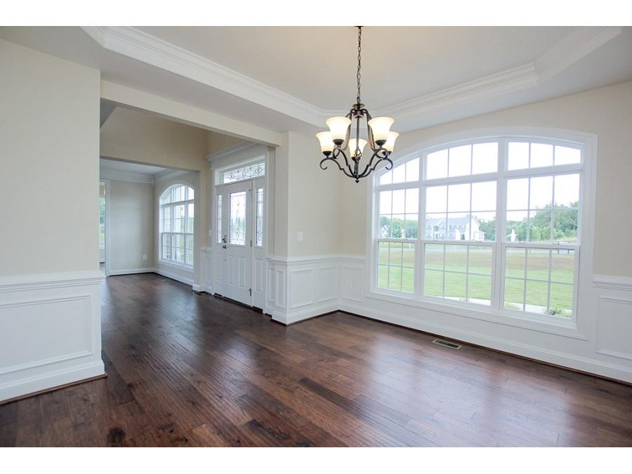 Dining Room Featuring Optional Hardwood Flooring, Trim Package and Upg. Chandelier Shown.