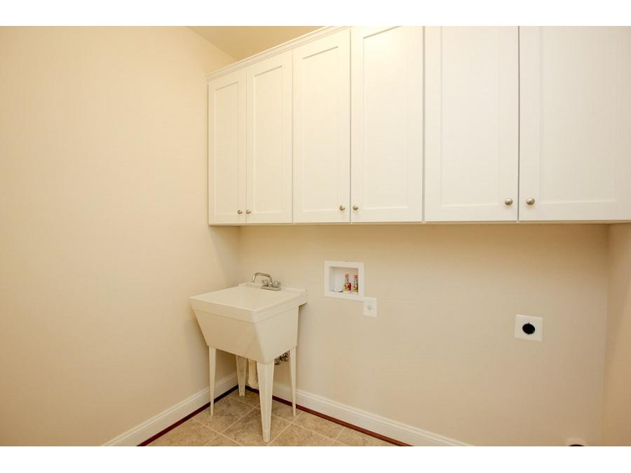 Laundry Room featuring Opt. Laundry Tub and Cabinets.