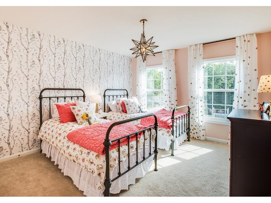 A shared girls' bedroom in the Saratoga Woods Chelsey Model