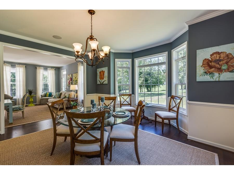 The Chelsey Dining Room featuring Bay Window and Hardwood Flooring