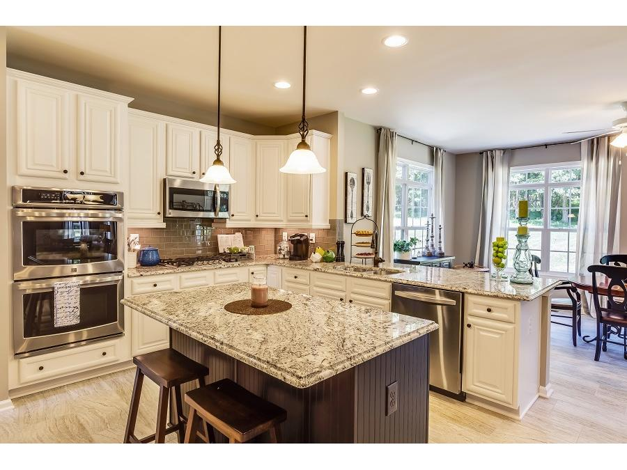 The Chelsey featuring a Gourmet Kitchen, Ceramic Tile flooring, Pendant Lights and more