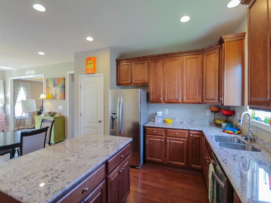 Jackson Kitchen featuring Granite Countertops, Tier 2 Cabinets and Stainless Steel Appliances