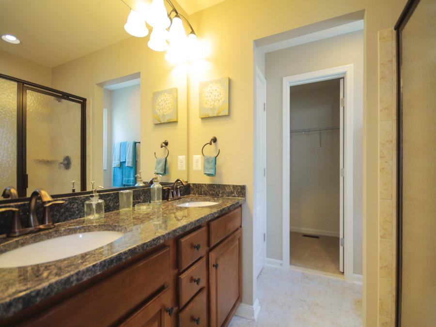 Jackson Master Bath, featuring Granite Countertops and Tier 2 Cabinets and Tier 2 Ceramic Tile