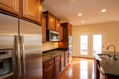 Kitchen featuring granite countertops and stainless steel appliances