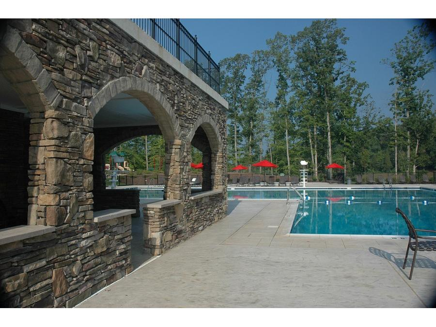 Beautiful stone arches accent the pool area.