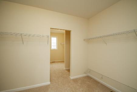 The gigantic walk in closet in the master bedroom features two sections
